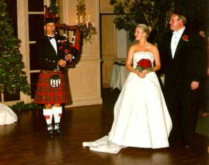 photo of dan sheppard playing the pipes at a Christmas wedding