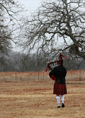 photo of dan sheppard playing the bagpipes